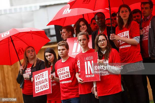 Supporters for the UK opposition Labour Party hold up banners at a launch event for the 'Labour In Britain' campaign bus in London UK on Tuesday May...