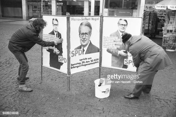 SPD supporters for Vogel put up posters as HansJochen Vogel top candidate of the SPD Social Democratic Party campaigns on January 29 1983 in Erlangen...