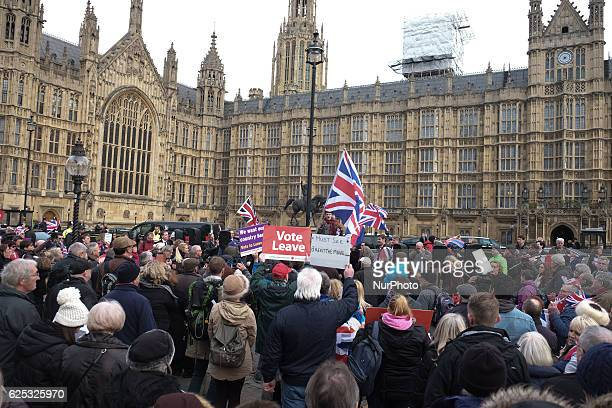 Supporters form summer's EU referendum gather in London on November 23 2016 to call for the Prime Minister to invoke article 50 of the Lisbon treaty
