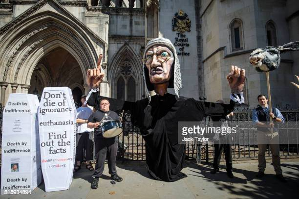Supporters from the group Distant Voices who oppose the liberalisation of euthanasia laws demonstrate with a giant puppet of a judge outside the...