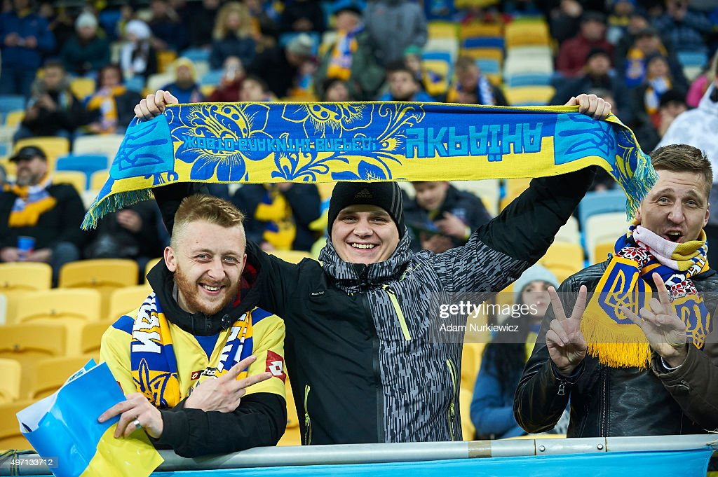 Supporters from Ukraine smile and pose during the warm up before the UEFA EURO 2016 Play-off for Final Tournament, First leg between Ukraine and Slovenia at Lviv Arena on November 14, 2015 in Lviv, Ukraine.