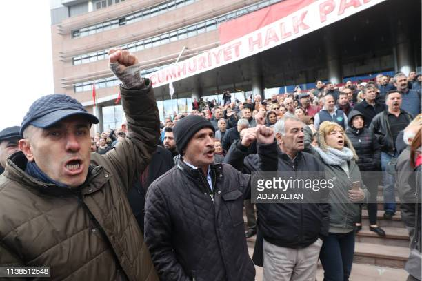 Supporters gather as the chairman of the Republican People's Party Kemal Kilicdaroglu address the crowd outside the CHP's Headquarters in Ankara...