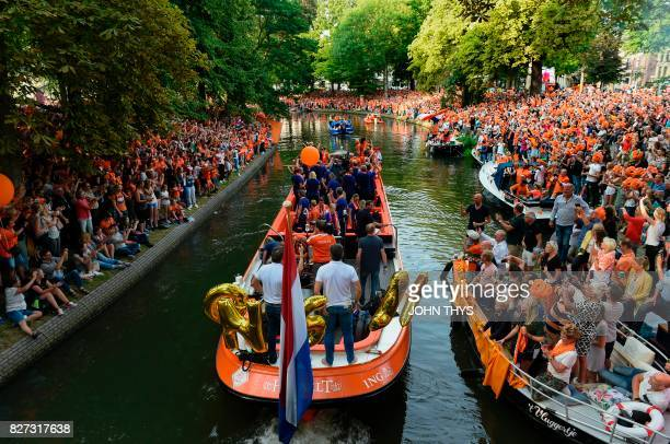 Supporters gather as the Dutch player's football women team celebrate the victory on a boat in Utrecht on August 7 2017 after Dutch women players's...