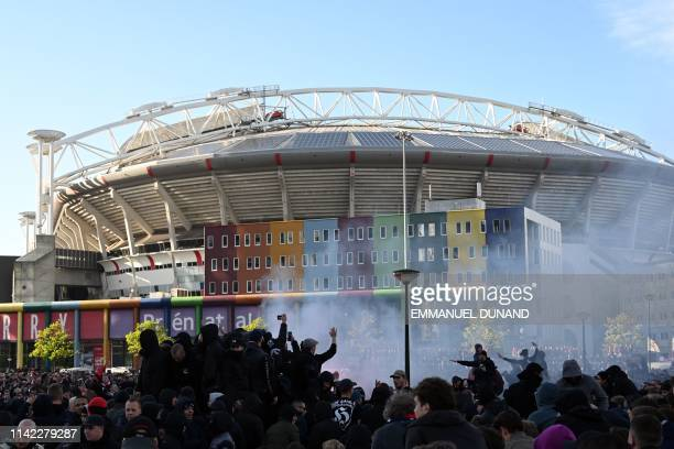 Supporters gather at the entrance of the stadium prior to the UEFA Champions League semifinal second leg football match between Ajax Amsterdam and...