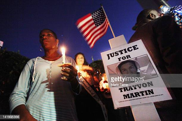 Supporters gather during a candelight vigil at a memorial to Trayvon Martin outside The Retreat at Twin Lakes community where Trayvon was shot and...
