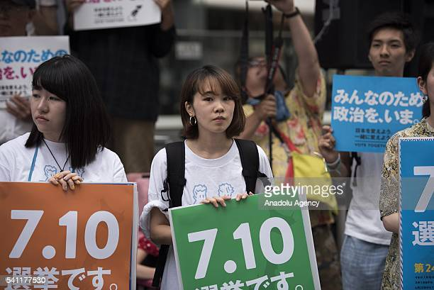 Supporters gather during the coalition's election event before the official start of the election campaign next week on June 19, 2016 in Tokyo,...