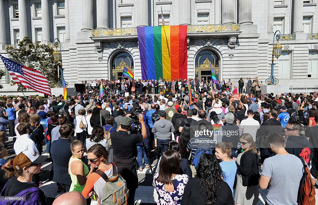 Supporters gather for a news conference outside City Hall after the U.S. Supreme Court same-sex marriage ruling in San Francisco, California, U.S., on Friday, June 26, 2015. Same-sex couples have a constitutional right to marry nationwide, the U.S. Supreme Court said in a historic ruling that caps the biggest civil rights transformation in a half-century. Photographer: Josh Edelson/Bloomberg via Getty Images