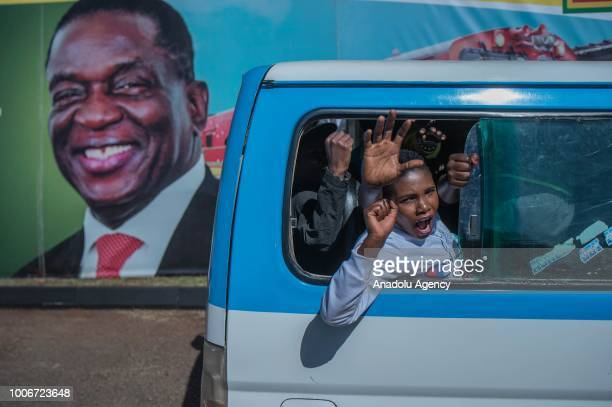 Supporters gather for the election rally of the ruling Zimbabwe African National Union Patriotic Front at the National Sports Stadium in Harare,...