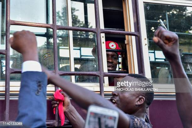 Supporters gather in solidarity with opposition figurehead Hon Kagulanyi Robert aka Bobi Wine gesturing inside the prison bus leading him to Luzira...