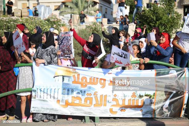 Supporters gather near Raed Salah's house after Palestinian resistance icon Raed Salah was released from jail to house arrest in Haifa Israel on July...