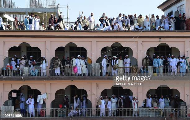 Supporters gather to attend the funeral prayers for key cleric Maulana Sami UlHaq during his funeral ceremony in his hometown of Akora Khattak...