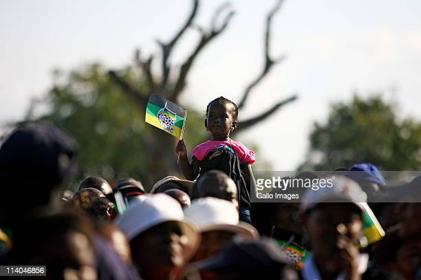 Supporters gather to hear South African President Jacob Zuma address the crowd as part of the African National Congress' election campaign on May 10,...