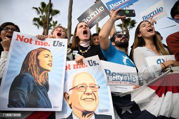 TOPSHOT Supporters gather to hear US Democratic presidential candidate Bernie Sanders speak at a rally in the Venice Beach neighborhood of Los...