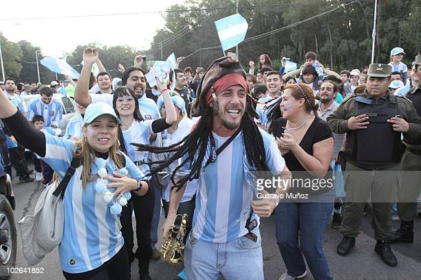 Supporters gather to receive the Argentina national soccer team on July 4 2010 in Buenos Aires Argentina