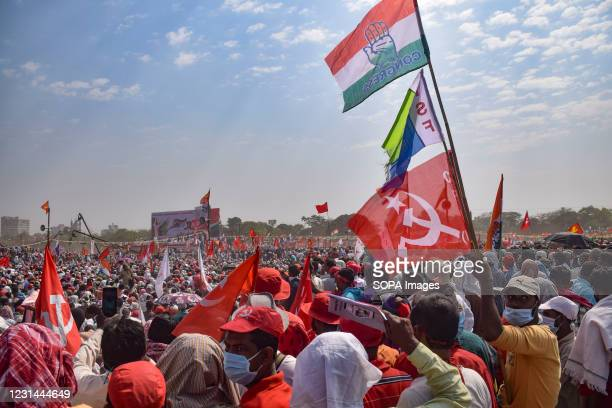 Supporters gather while holding flags during the mega rally. The Communist party CPIM launches a mega rally with its allies the Congress and The...