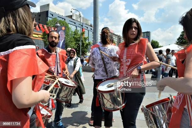 Supporters get ready their drums ahead of a march staged by the main opposition Republican People's Party for the early presidential and...
