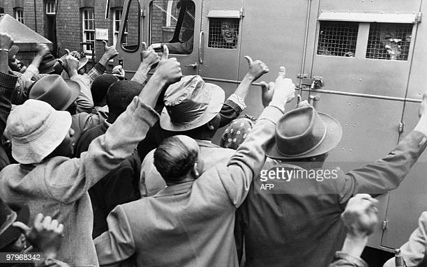 ANC supporters give the thumb up as a prison van with antiapartheid militants go to Johannesburg's courthouse 28 December 1956 152 antiapartheid...