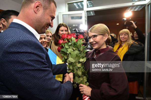 Supporters greet former Ukrainian Prime Minister Yulia Tymoshenko after she submitted documents to the Ukraines Central Electoral Commission in Kiev...