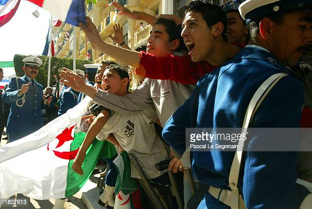 Supporters greet French President Jacques Chirac during an arrival ceremony March 4 2003 in Oran Algeria Chirac the first French leader on a full...
