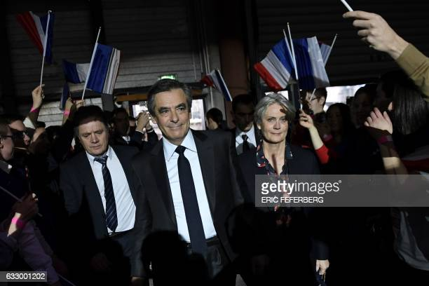 Supporters greet French right wing candidate for the upcoming presidential election Francois Fillon and his wife Penelope Fillon as they arrive for a...