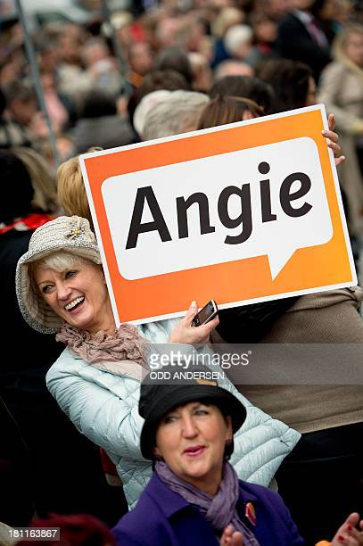 Supporters greet German Chancellor Angela Merkel at an election campaign event of her German Christian Democratic Union party in the central German...
