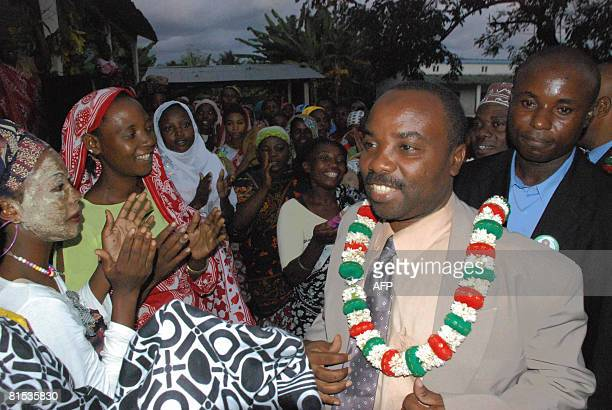Supporters greet presidential candidate Moussa Toybou on June 12 2008 as he arrives for a campaign rally in Anjouan Comoros The head of the Comoran...