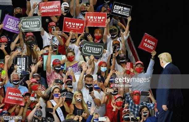 Supporters greet U.S. President Donald Trump as he arrives at a campaign event at Xtreme Manufacturing on September 13, 2020 in Henderson, Nevada....
