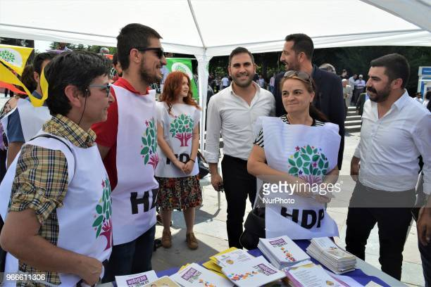 Supporters hand out brochures during the opening of a new election campaign booth of the proKurdish Peoples' Democractic Party for the early...