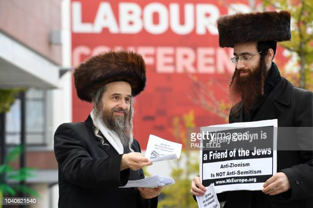 Supporters hand out leaflets outside the venue on the final day of the Labour party conference in Liverpool north west England on September 26 2018...