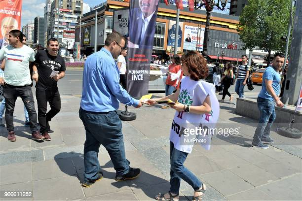 A supporters hands out brochures during the opening of a new election campaign booth of the proKurdish Peoples' Democractic Party for the early...