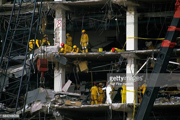 Supporters have posted a banner to encourage rescue workers who are sifting through the rubble of the destroyed Federal Building in the aftermath of...
