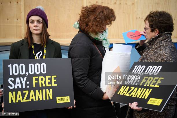Supporters hold a collection of letters and posters calling for the release of jailed UK-Iranian woman Nazanin Zaghari-Ratcliffe before delivering...
