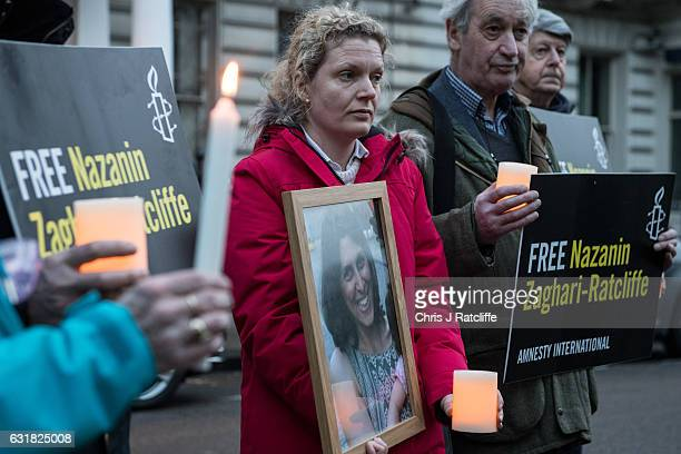 Supporters hold a photo of Nazanin Zaghari-Ratcliffe, candles and signs during a vigil for British-Iranian mother, Nazanin Zaghari-Ratcliffe,...