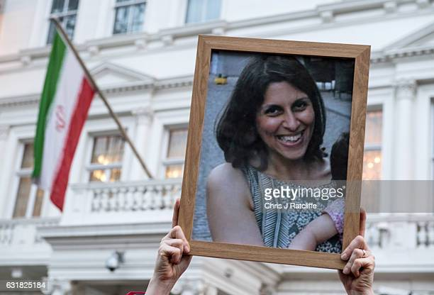 Supporters hold a photo of Nazanin Zaghari-Ratcliffe during a vigil for British-Iranian mother, Nazanin Zaghari-Ratcliffe, imprisoned in Tehran...