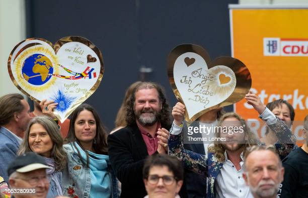 Supporters hold a transparent in form of a heart with the slogan 'Angie I love you' as the wait for German Chancellor and leader of the German...