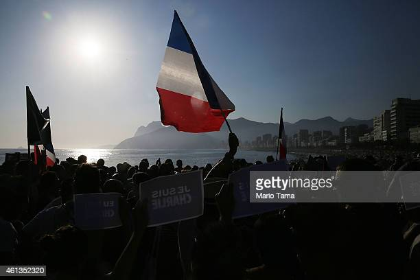 Supporters hold 'Je Suis Charlie' signs during the Unity Rally at Ipanema beach on January 11 2015 in Rio de Janeiro Brazil The Unity Rally held...
