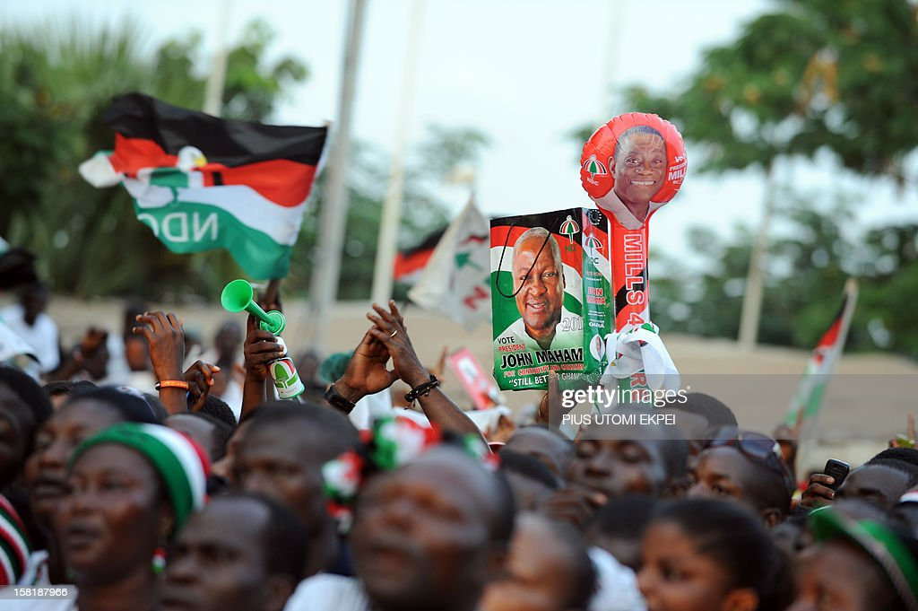 Supporters hold party souvenirs to cheer re-elected Ghanaian President John Dramani Mahama during a rally to accept his mandate at Kwame Nkrumah Circle in Accra on December 10, 2012. Local observers on December 10 urged respect for Ghana's election results giving victory to Mahama after the opposition alleged fraud in a nation trying to uphold its image as a model African democracy. According to the electoral commission, Mahama won with 50.70 percent of the votes cast, compared to opposition candidate Nana Akufo-Addo's 47.74 percent. With eight candidates in the race, more than 50 percent was needed to avoid a second-round runoff.