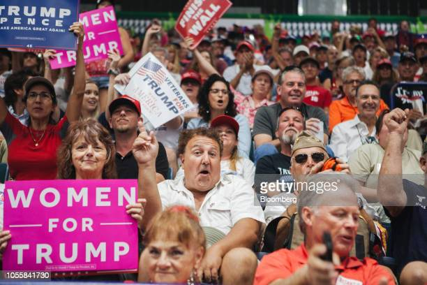 Supporters hold placards ahead of a campaign rally with US President Donald Trump and Representative Ron DeSantis Republican candidate for governor...