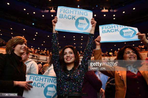 Supporters hold placards as British politician and The Brexit Party leader Nigel Farage addresses the first public rally of their European Parliament...