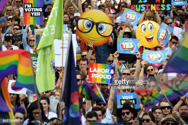 Supporters hold placards as they attend a samesex marriage rally in Sydney on September 10 2017 Thousands of samesex marriage supporters on September...