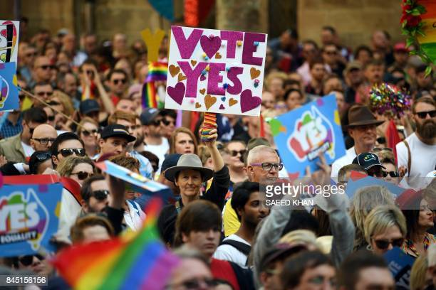 TOPSHOT Supporters hold placards as they attend a samesex marriage rally in Sydney on September 10 2017 Thousands of samesex marriage supporters on...