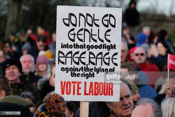 Supporters hold placards as they gather for a stump speech by Labour leader Jeremy Corbyn at the Sporting Lodge Inn on December 11 2019 in...