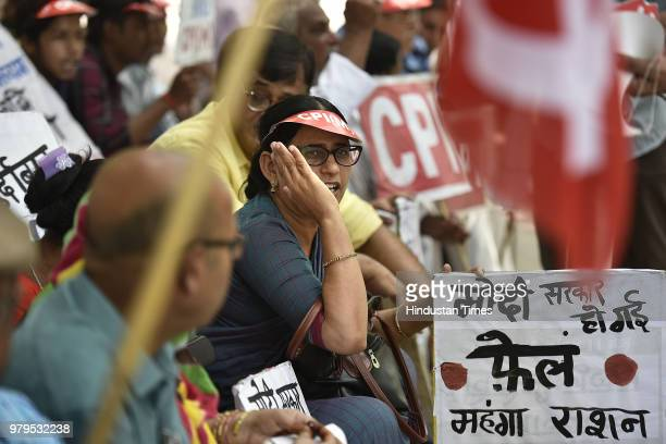 CPIM supporters hold placards as they shout slogans protesting against the inflation at Parliament street on June 20 2018 in New Delhi India