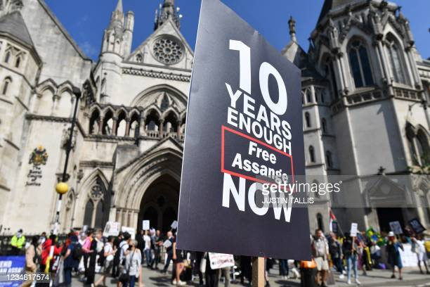 Supporters hold placards in support of Wikileaks founder Julian Assange, outside the Royal Courts of Justice in the City of London on August 11...