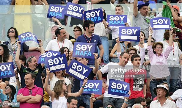 Supporters hold placards reading 'I am Rafa' and 'I am Andy' during the men final of Madrid Open tournament at the Caja Magica sports complex between...