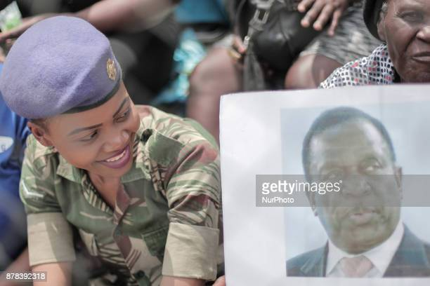 Supporters hold posters of Zimbabwean newly swornin President Emmerson Mnangagwa during the Inauguration ceremony at the National Sport Stadium in...