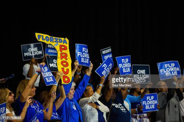 Supporters hold signs as former Florida gubernatorial candidate Andrew Gillum addresses the audience during an event on March 20 2019 in Miami...