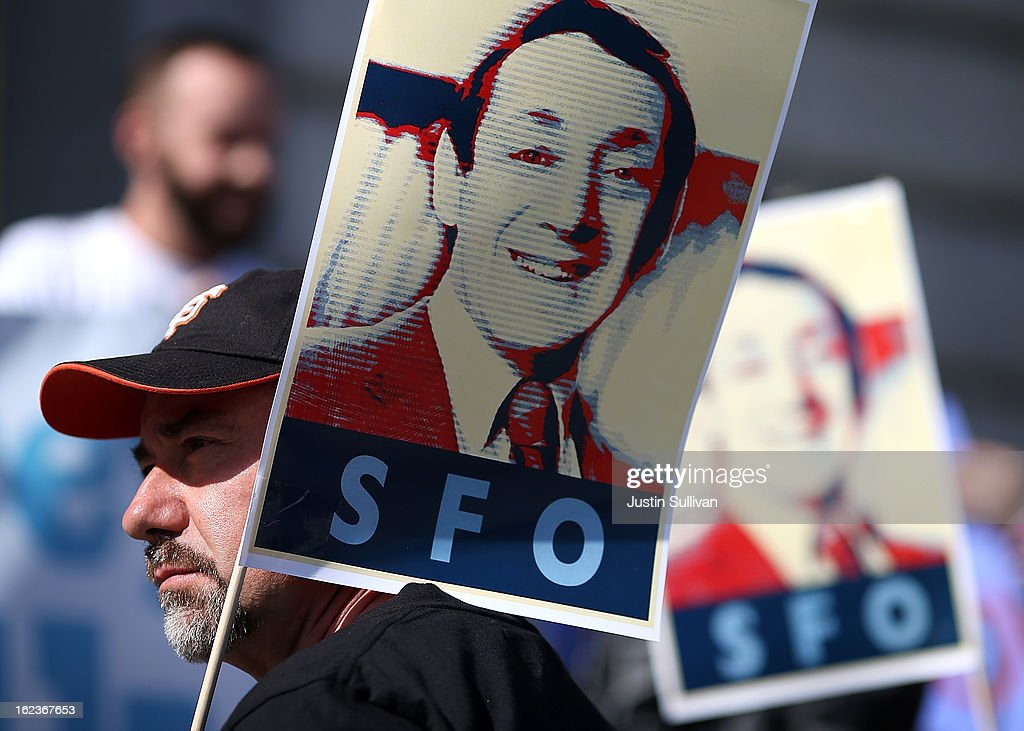 Supporters hold signs with the image of slain San Francisco supervisor Harvey Milk during a rally at San Francisco City Hall on February 22, 2013 in San Francisco, California. Dozens of supporters staged a rally in front of San Francisco City Hall to support San Francisco supervisor David Campos's Harvey Milk SFO charter amendment that aims to change the name of the San Francisco International Airport to Harvey Milk SFO in honor of the Milk who was the first openly gay elected official in the United States. Milk was assassinated on November 27, 1978 along with then San Francisco Mayor George Moscone by Dan White, a San Francisco supervisor who had recently resigned.