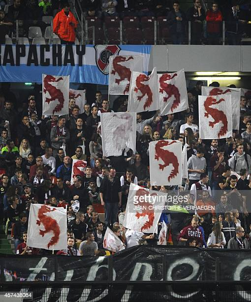 Supporters hold the logo of the FC Metz during the French L1 football match Metz against Rennes at Saint Symphorien stadium on October 18 2014 in...