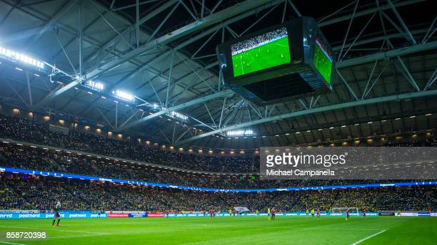 Supporters hold their phones up during the FIFA 2018 World Cup Qualifier between Sweden and Luxembourg at Friends arena on October 7 2017 in Solna...